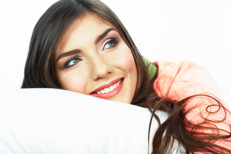 awaking: Bed time smiling  woman portrait. White background isolated.