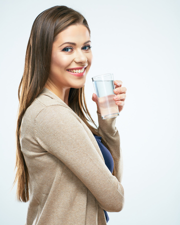 Water glass. Beautiful girl hold water. White background isolated.