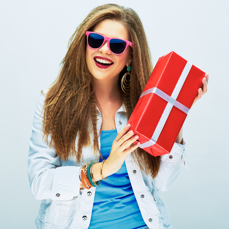 happy smiling woman hold red gift . white studio background .