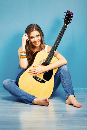 teenager girl with acoustic guitar in city style . fashion music look with young model Stock Photo