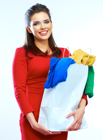 beautiful woman in red dress holding shopping bag isolated on white background.