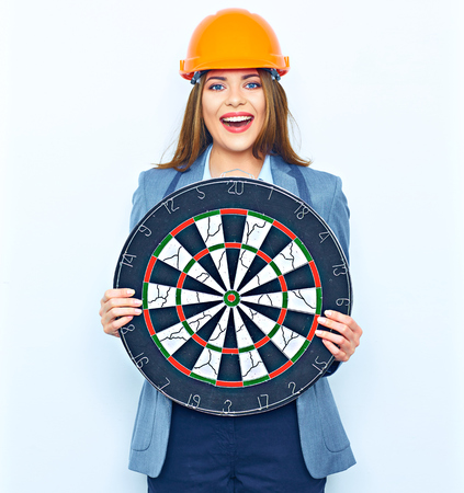 Business woman architect hold target. Smiling young woman standing against white background.