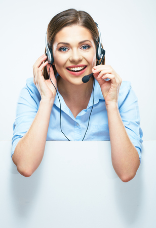 hotline: Woman operator with headset and blank sign board. Isolated portrait of smiling help line operator.