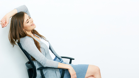 chear: woman office worker sitting in chear. smiling business woman isolated portrait on white. Stock Photo