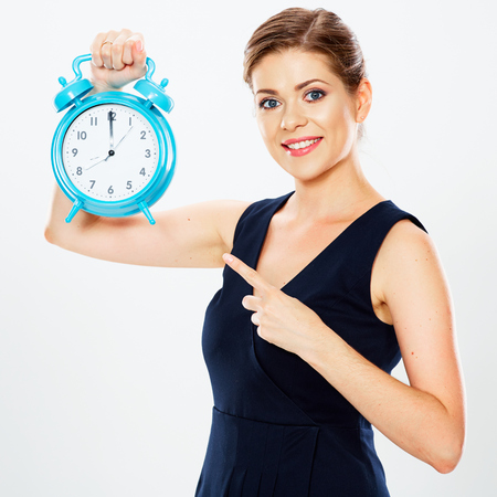 vestidos de epoca: Business woman pointing her finger on watch. White background isolated. Time concept.