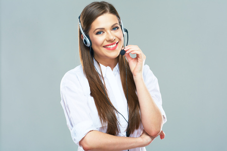 Smiling woman operator of call center support. Isolated portrait of beautiful woman with headset.