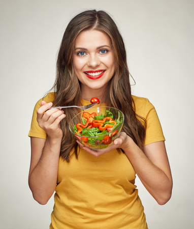 healthy life style with smiling woman eating vegetarian salad. isolated portrait. Foto de archivo