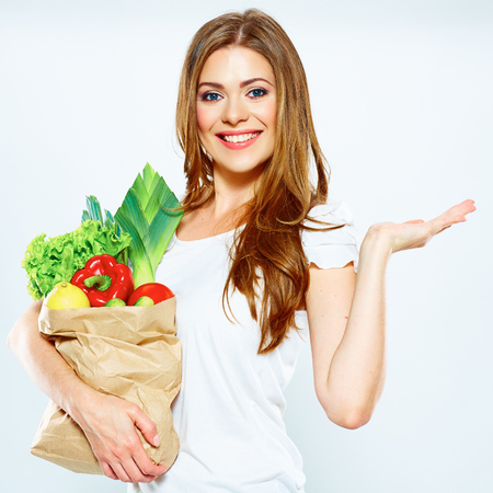 Woman with green food show empty hand. white background .