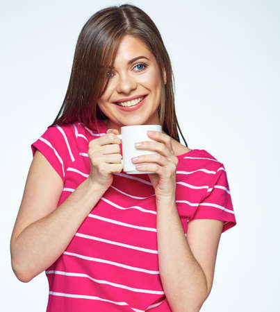 tea hot drink: Smiling girl drink tea. Isolated white background female portrait.
