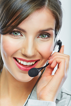 customer service representative: Customer support operator. Woman face.Call center smiling operator with phone headset. Stock Photo