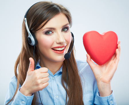 Woman call center operator hold love symbol Red heart. Thumb.  Close up business woman portrait. Фото со стока