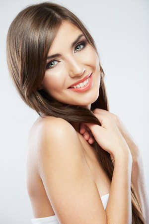 pelo castaño claro: Beautiful young woman portrait isolated on studio background. Close up face. Long hair Foto de archivo