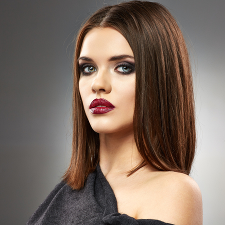 Beautiful model with straight Hair Style. Red lips. Beauty face portrait. 版權商用圖片