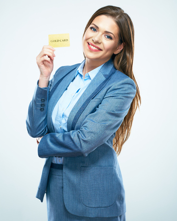 Business woman in suit credit card show. White background isolated.