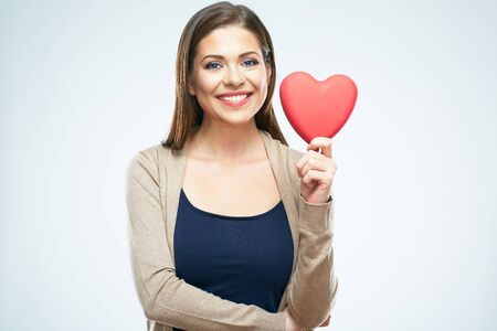 Beautiful woman hold red heart. Valentine day love concept. Isolated portrait on white background. Smile with teeth.