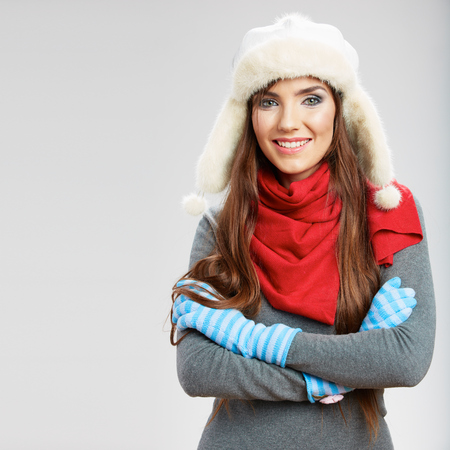 winter fashion: Casual winter style yong smiling woman portrait. Girl studio isolated, posing white background. Female young model.