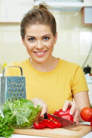 woman cooking  healthy food in the kitchen with knife