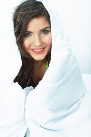 Bed time smiling  woman portrait. White background isolated.