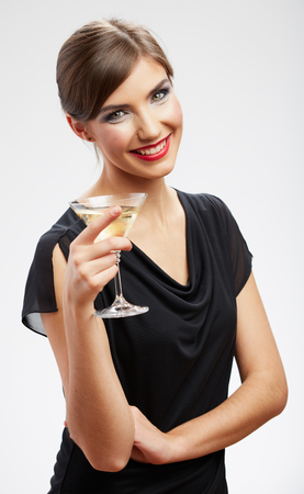 winter fashion: Happy celebrate woman portrait isolated on white background. Wine drink girl with red lips. Stock Photo
