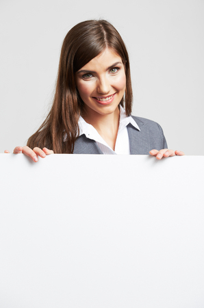 sheet: Smile Business woman portrait with blank white board on gray isolated . Female model with long hair.