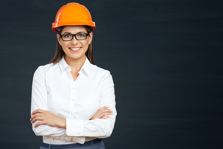 Smilind business builder woman portrait on black. 스톡 콘텐츠