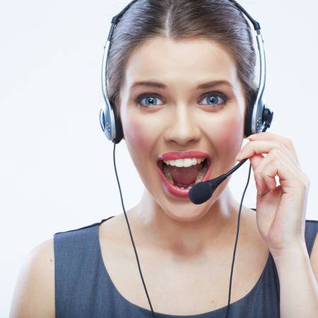 Close up face portrait o woman customer service worker isolated on white background, call center smiling operator with phone headset. Young female model.