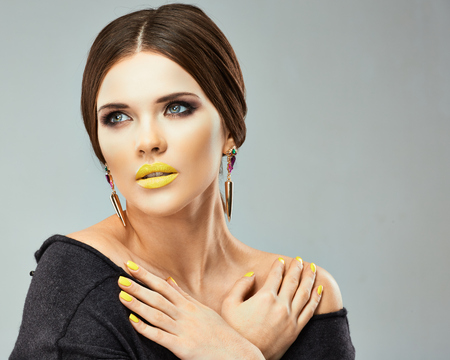 salon: Young beauty model. Beauty face woman close up portrait. Yellow lips.