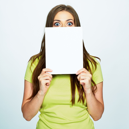 woman hold white banner in face . isolated portrait . 写真素材