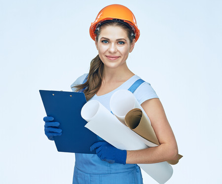 Woman builder holding blueprints, clipboard. Smiling architect girl. Isolated portrait. Stock Photo