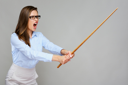 Wicked woman teacher screams, holding pointer wand. Isolated portrait,  Stockfoto