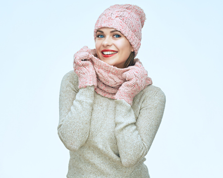 Happy smiling woman wearing winter warm clothes isolated portrait on white background.