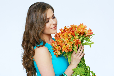 Close up face portrait of young woman with flowers. White background isolated.
