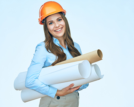Smiling student arhitect holding paper blueprints. Studio isolated portrait of young businesswoman architect.