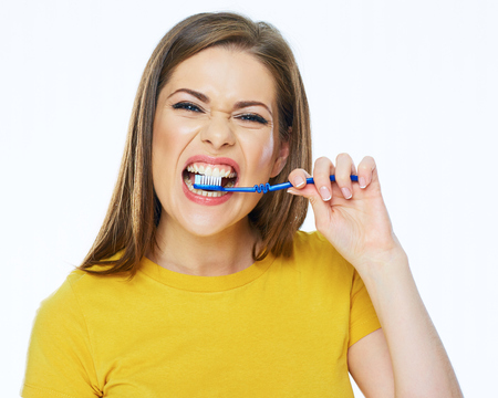 Funny woman with toothy brush. healthy lifestyle. White background isolated. 版權商用圖片