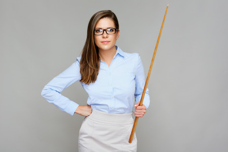 Bad teacher. Woman holding wooden pointer. Isolated portrait.
