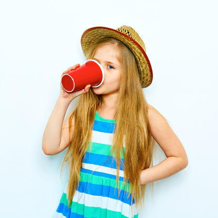 Little Girl drink coffee as adult. Hipster style parody on adult.