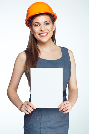 Smiling architect woman hold blank sign board. Isolated portrait.