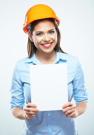 Business woman builder engineer, white blank board. White background isolated. 版權商用圖片