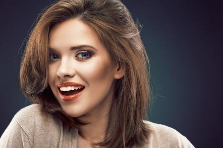 Beauty woman face portrait close up. Smiling beautiful girl.