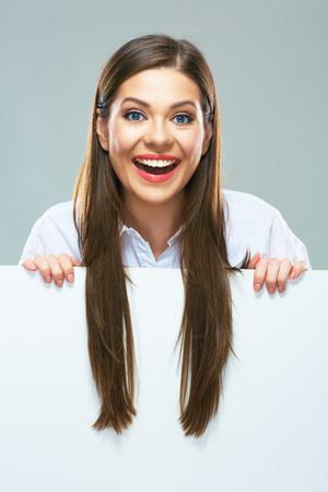 Smiling business woman  with long hair on white  sign board. Young female model smile with teeth. 版權商用圖片