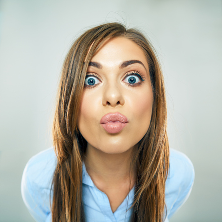 woman show kiss lips, face portrait of business woman. funny face isolated.