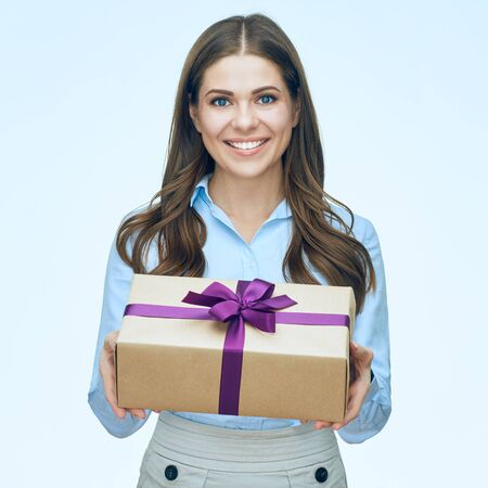 Smiling young woman with long hair holding gift box. isolated portrait.
