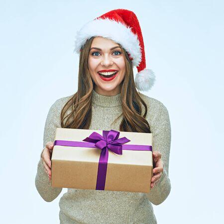 Smiling Santa girl holding gift box. Christmas holiday. Isolated portrait.
