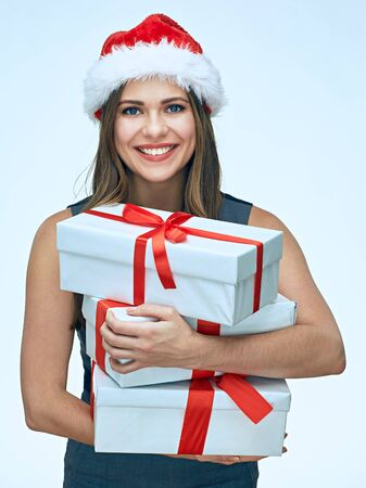 Christmas gift. Young business woman isolated portrait. Smiling santa girl.