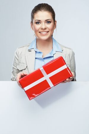 Smiling business woman red gift box hold. White card.