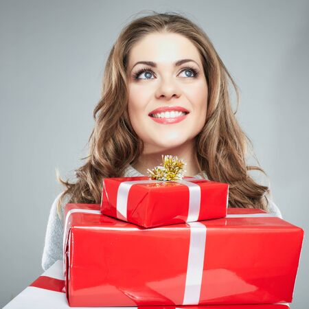 Young woman hold gift box . Smiling happy girl on white background. Female model.