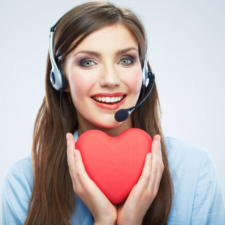 Woman call center operator hold love symbol Red heart. Close up business woman portrait.