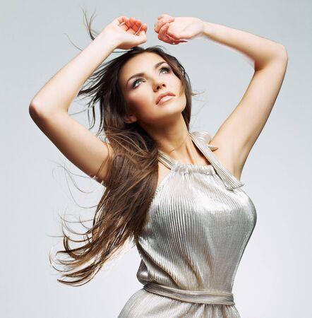 Blowing hair of young beautiful woman in evening dress . young model studio posing Stock fotó