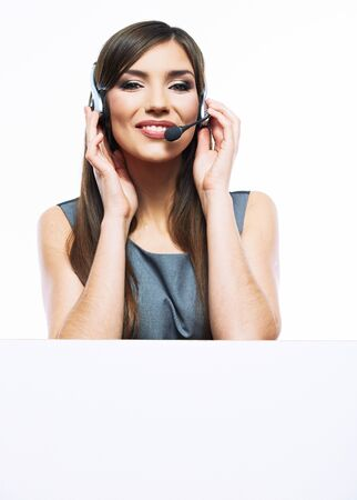 Close up portrait of Woman customer service worker with big blank board, call center smiling operator with phone headset isolated over white background.