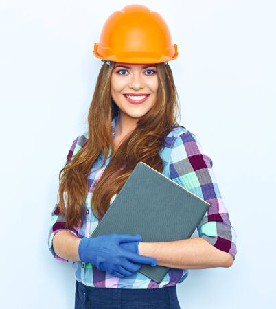 Woman architect hold business paper. Smiling girl portrait against white wall.  Woman worker builder.